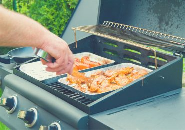Meat in foil pan on a 2 burner gas grill - the best 2 burner gas grills