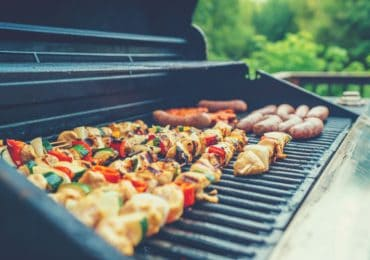 Spacious gas grill with pan on additional workspace - best gas grill under $200
