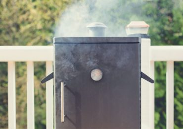 Smoking electric smoker on patio - electric vs. gas smoker
